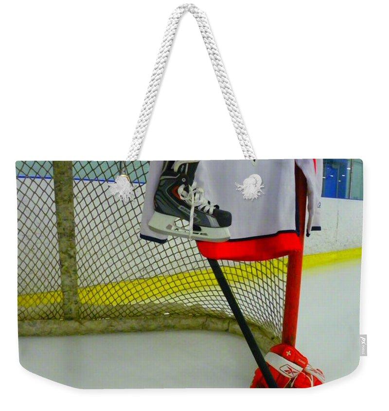 Washington Capitals Weekender Tote Bag featuring the photograph Washington Capitals Mike Green Away Hockey Jersey by Lisa Wooten