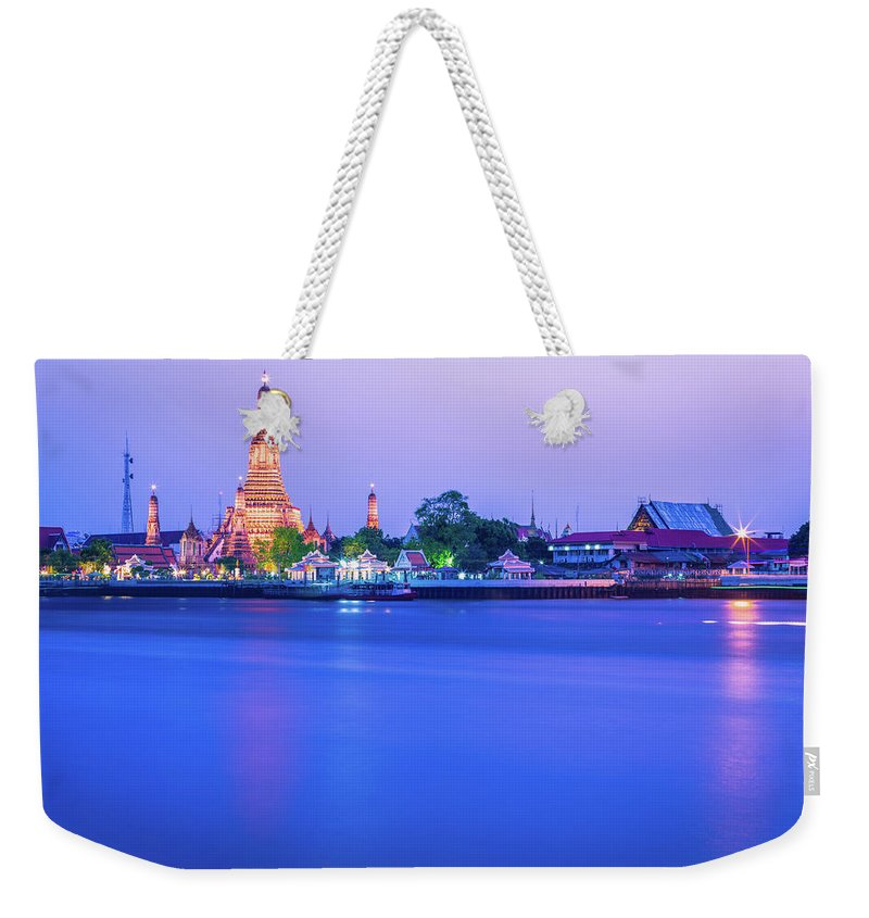 Scenics Weekender Tote Bag featuring the photograph Wat Arun Temple Bangkok Thailand by Deimagine