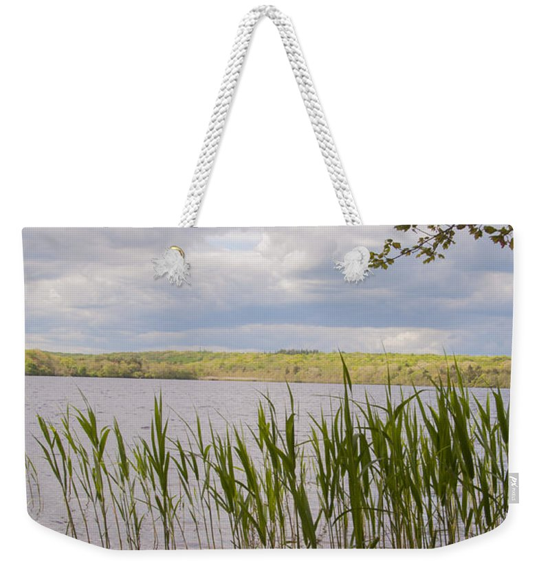 Photography Weekender Tote Bag featuring the photograph Watchaug Pond by Steven Natanson