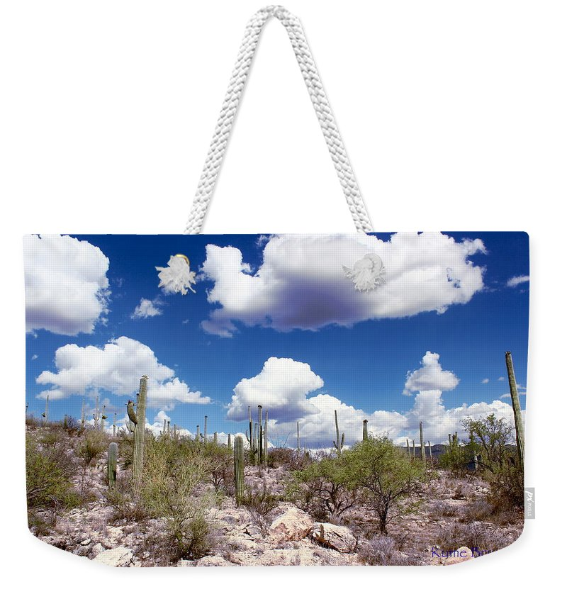 Beautiful Day Weekender Tote Bag featuring the photograph Watching The Clouds Go By by Kume Bryant