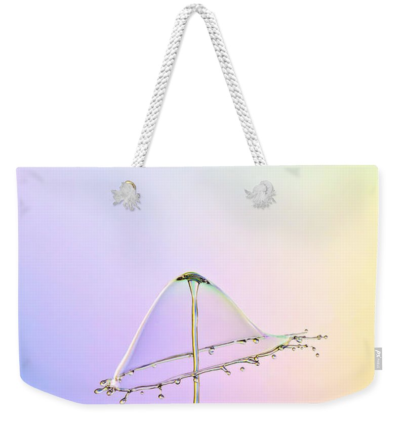 Water Weekender Tote Bag featuring the photograph Water Lamp by Susan Candelario