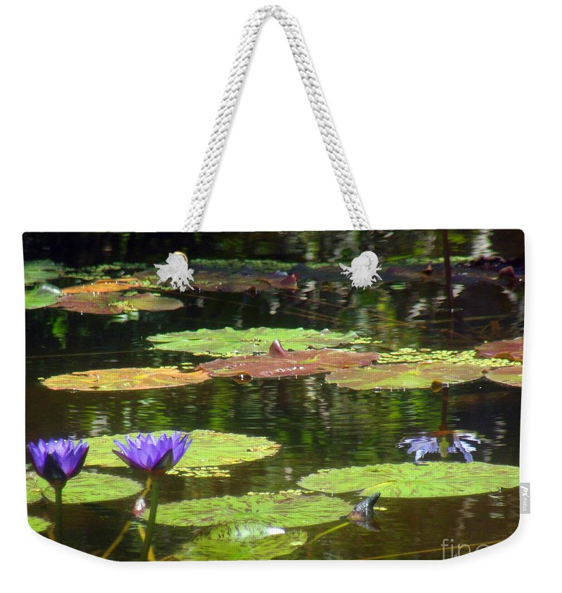 Purple Weekender Tote Bag featuring the photograph Water Lily Garden 2 by Jennifer Lavigne