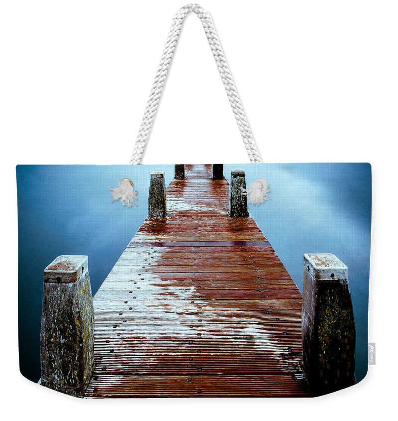 Wooden Pier Weekender Tote Bag featuring the photograph Water On The Jetty by Dave Bowman