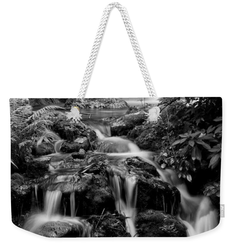 Black Weekender Tote Bag featuring the photograph Waterfall At Rainbow Springs by Beverly Stapleton