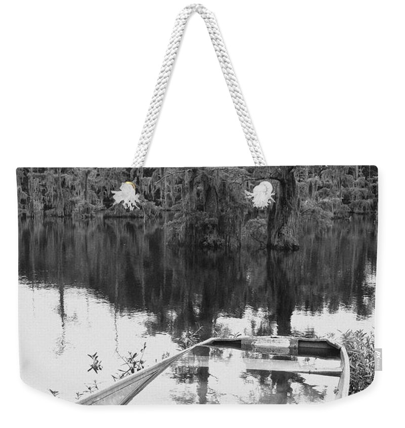 Boat Weekender Tote Bag featuring the photograph Waterlogged by Scott Pellegrin