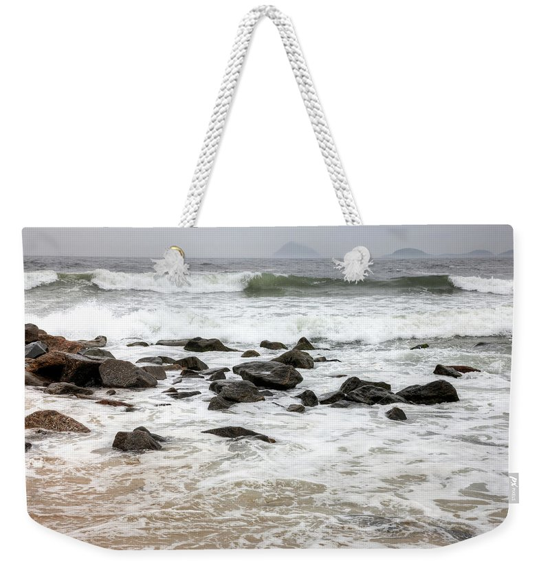 Water's Edge Weekender Tote Bag featuring the photograph Waves Crashing On Copacabana Beach In by Tirc83