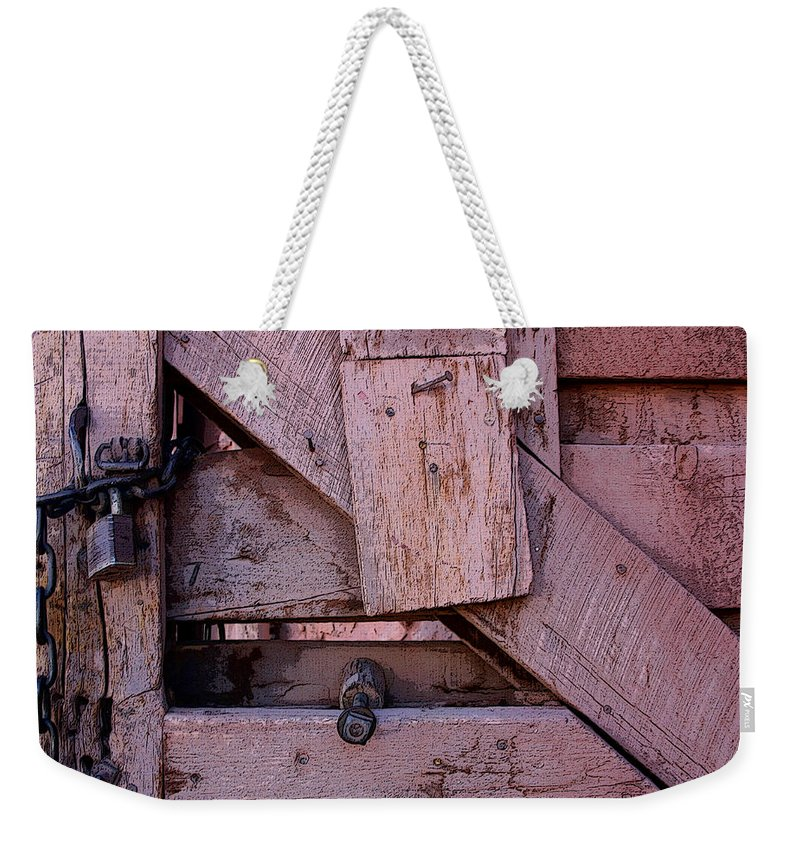 Gate Weekender Tote Bag featuring the digital art Weathered Gate With Lock And Chain by Joe Kozlowski