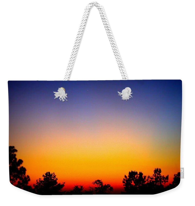 Sunset Weekender Tote Bag featuring the photograph Welcoming The Night by Paul Wilford