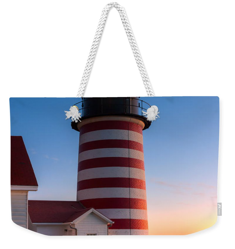 Clarence Holmes Weekender Tote Bag featuring the photograph West Quoddy Head Light At Dawn I by Clarence Holmes