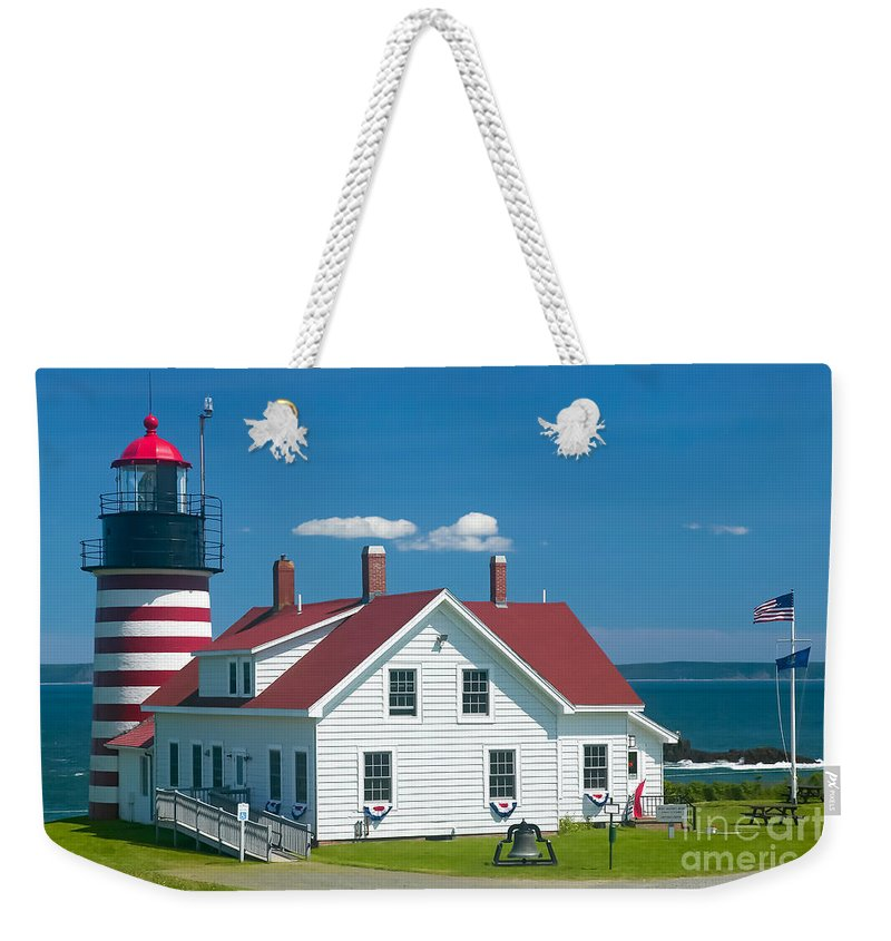 Clarence Holmes Weekender Tote Bag featuring the photograph West Quoddy Head Light by Clarence Holmes