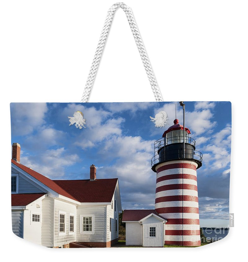 Lubec Weekender Tote Bag featuring the photograph West Quoddy Head Lighthouse by John Greim