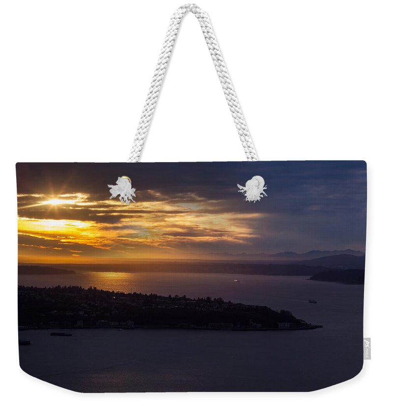 Seattle Weekender Tote Bag featuring the photograph West Seattle Sunset Sunstar by Mike Reid
