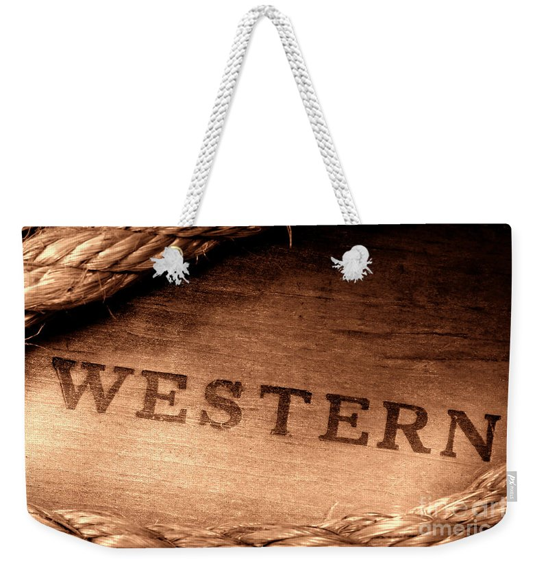 Western Weekender Tote Bag featuring the photograph Western Stamp Branding by Olivier Le Queinec