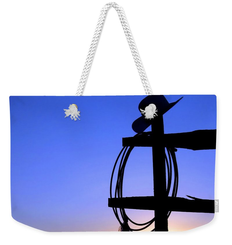 Western Weekender Tote Bag featuring the photograph Western Sunset by Olivier Le Queinec