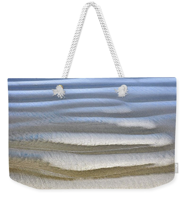 Beach Weekender Tote Bag featuring the photograph Wet Sand Texture On Ocean Shore by Elena Elisseeva