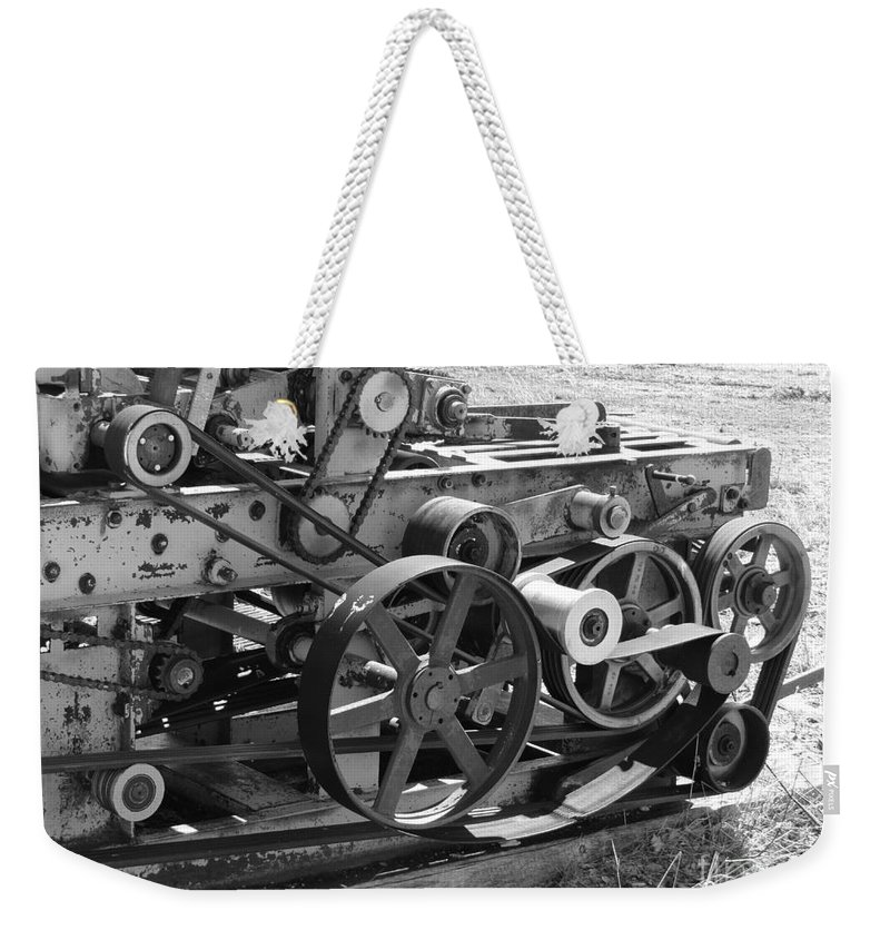 Prairie Weekender Tote Bag featuring the photograph Wheels Gears And Cogs by Mary Mikawoz