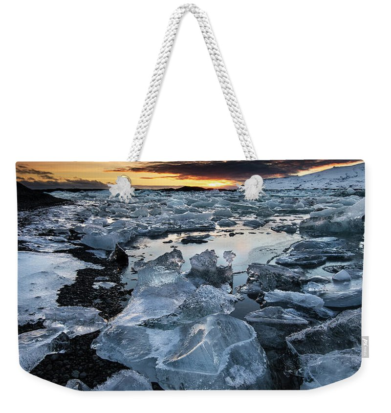 Scenics Weekender Tote Bag featuring the photograph When The Sun Says ... Goodbye by Cresende
