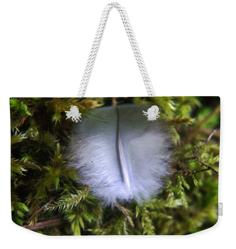 Feathers. Moss Weekender Tote Bag featuring the photograph Where A Feather Finds Itself by Jeff Swan