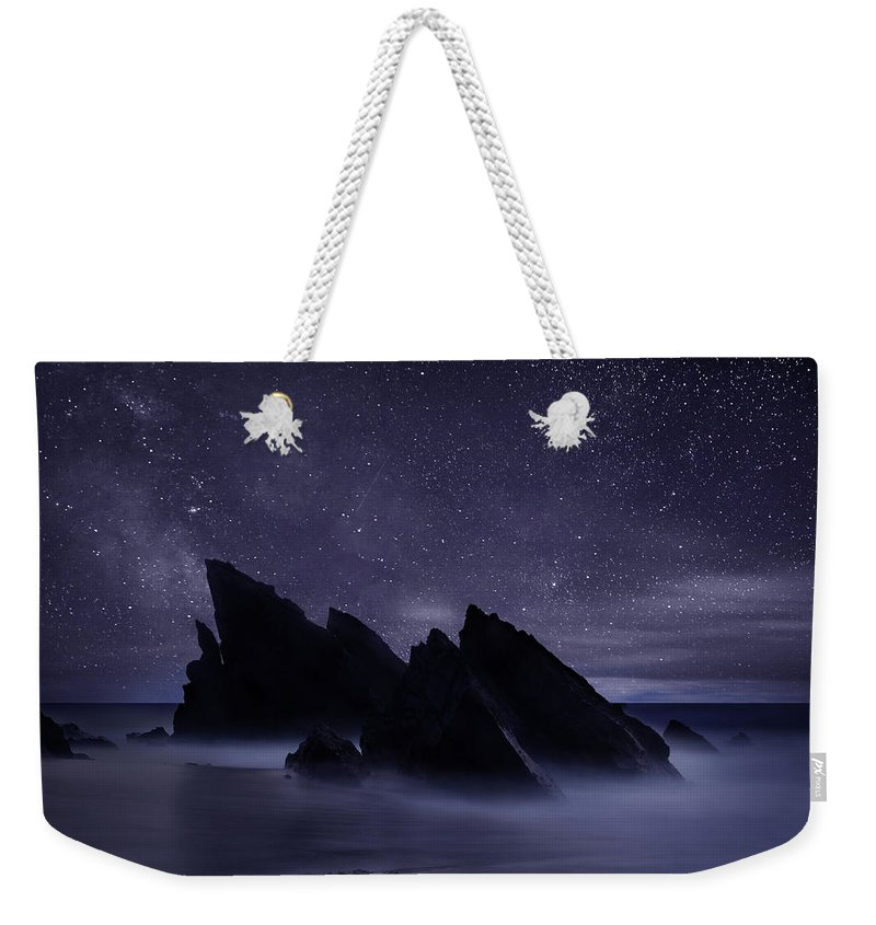 Night Weekender Tote Bag featuring the photograph Whispers of eternity by Jorge Maia