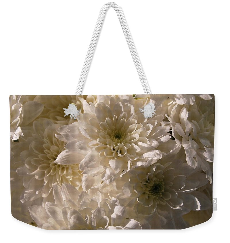 Weekender Tote Bag featuring the photograph White And Pure by Riad Belhimer