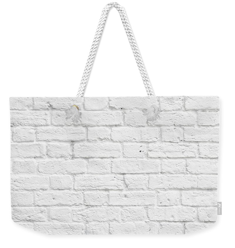 Brick Weekender Tote Bag featuring the photograph White Brick Wall by Dutourdumonde Photography