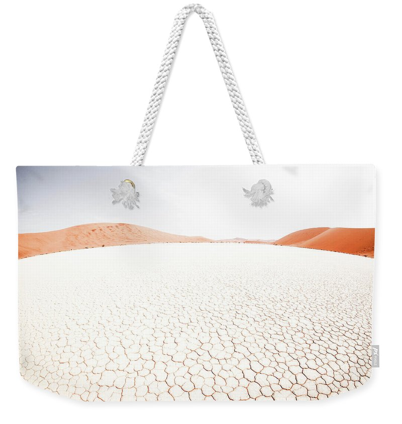 Tranquility Weekender Tote Bag featuring the photograph White Clay Pan And Dunes by Taken By Chrbhm