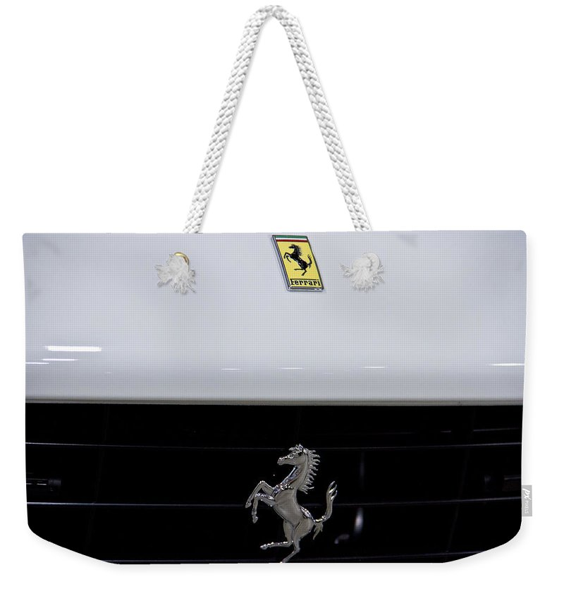 Motor Weekender Tote Bag featuring the photograph White Ferrari-emblem And Gril by Eti Reid