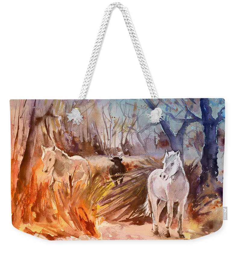 Travel Weekender Tote Bag featuring the painting White Horses And Bull In The Camargue by Miki De Goodaboom