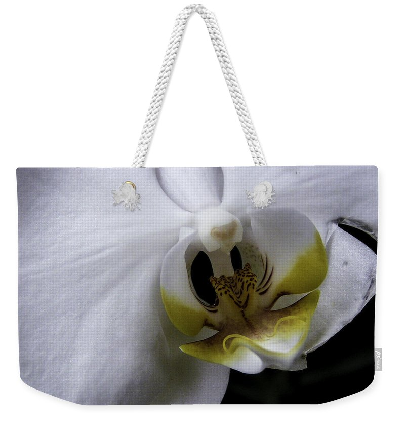 Flower Weekender Tote Bag featuring the photograph White Orchid by Lovejoy Creations