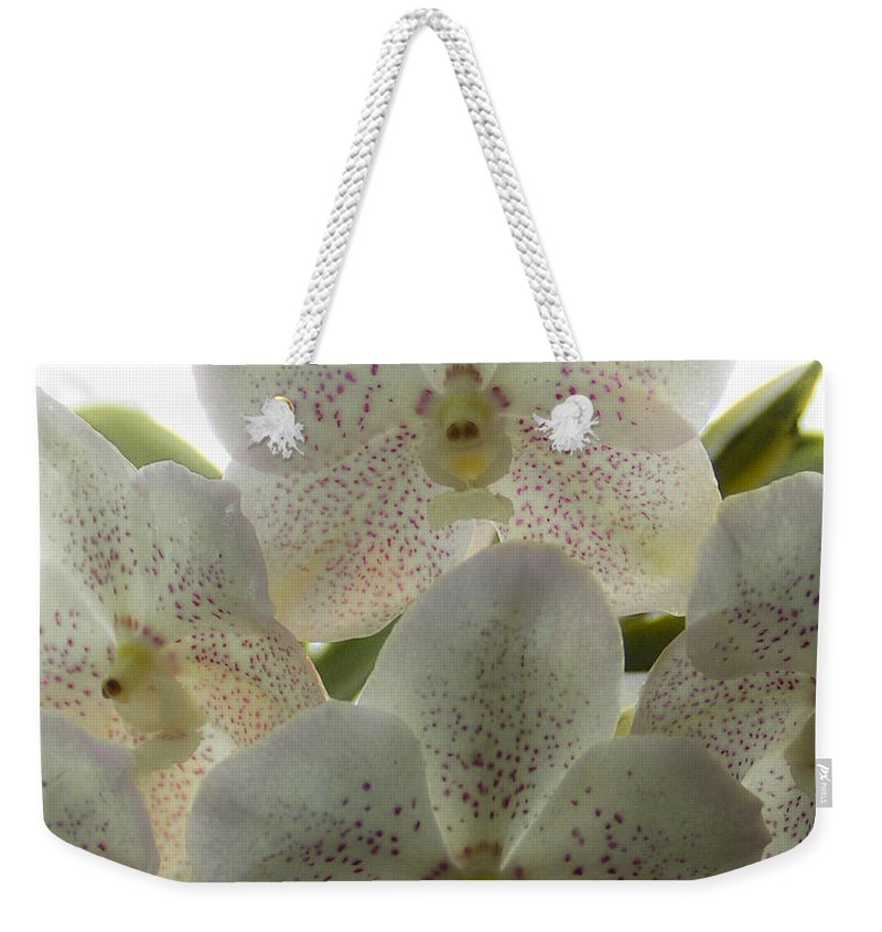 Lovejoy Weekender Tote Bag featuring the photograph White Orchids by Lovejoy Creations