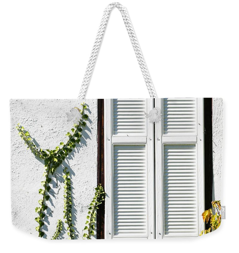 White Weekender Tote Bag featuring the photograph White Painted Shutter by Marilyn Hunt