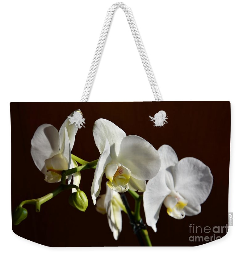 Orchids Weekender Tote Bag featuring the photograph White by Ramona Matei