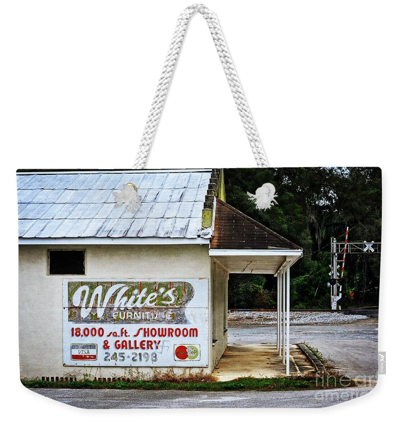 White's Furniture Weekender Tote Bag featuring the photograph White's Furniture by Mary Machare
