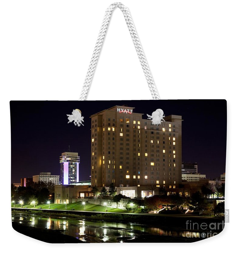 Arkansas River Weekender Tote Bag featuring the photograph Wichita Hyatt Along The Arkansas River by Bill Cobb