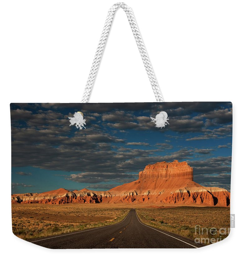 North America Weekender Tote Bag featuring the photograph Wild Horse Butte And Road Goblin Valley Utah by Dave Welling
