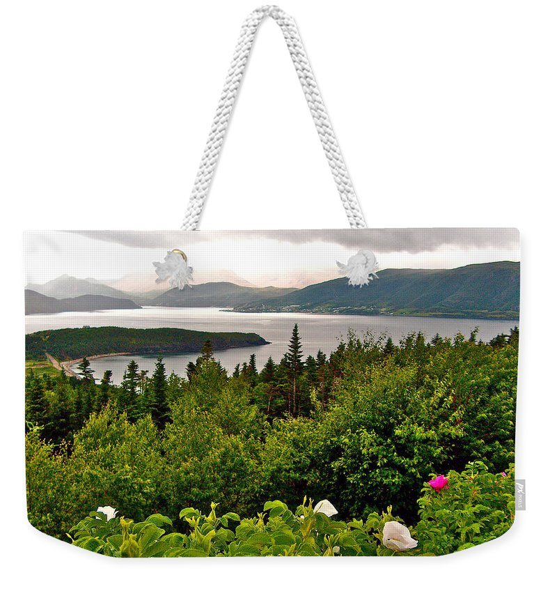 Wild Roses At Photographer's Point Overlooking Bonne Bayin Gros Morne Np Weekender Tote Bag featuring the photograph Wild Roses At Photographer's Point Overlooking Bonne Bay In Gros Morne Np-nl by Ruth Hager