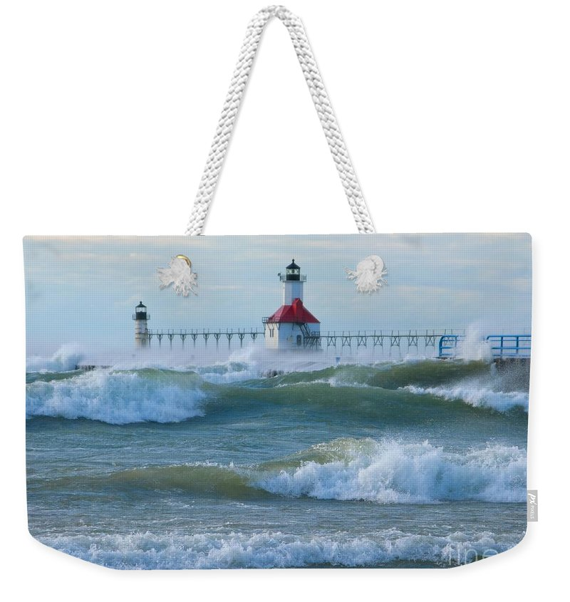 Wind Weekender Tote Bag featuring the photograph Wind-borne Fury by Ann Horn