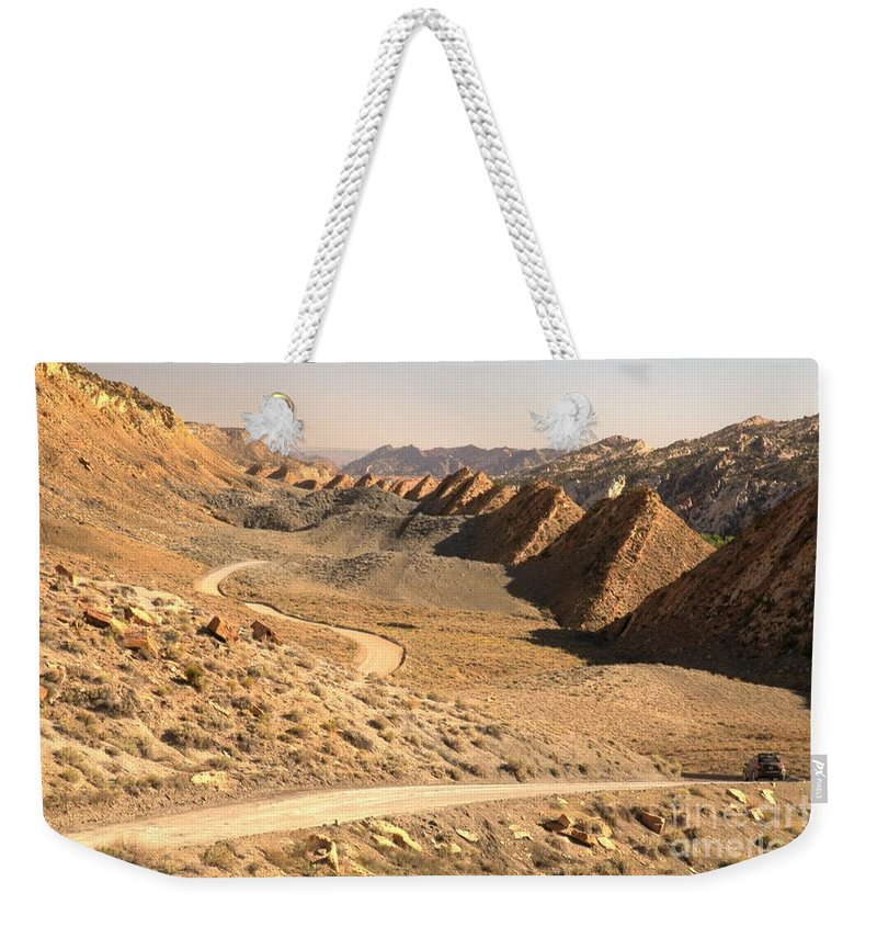 Cottonwood Road Weekender Tote Bag featuring the photograph Winding Through The Coxcomb by Adam Jewell