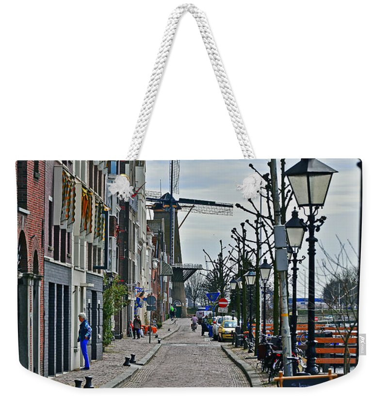 Travel Weekender Tote Bag featuring the photograph Windmill At The End Of The Street by Elvis Vaughn