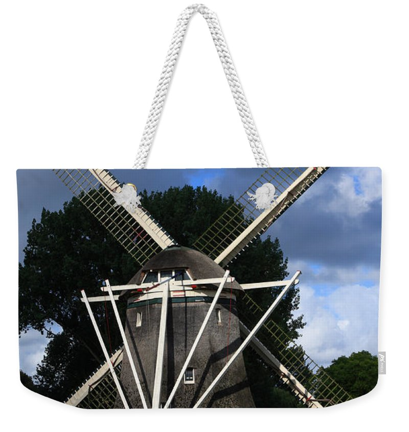 Windmill Weekender Tote Bag featuring the photograph Windmill In Dutch Countryside by Aidan Moran