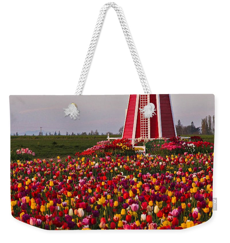 Windmill Weekender Tote Bag featuring the photograph Windmill Of Flowers by Athena Mckinzie