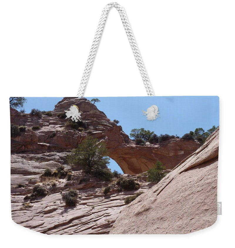 Weekender Tote Bag featuring the photograph Window Rock 2 by Katerina Naumenko