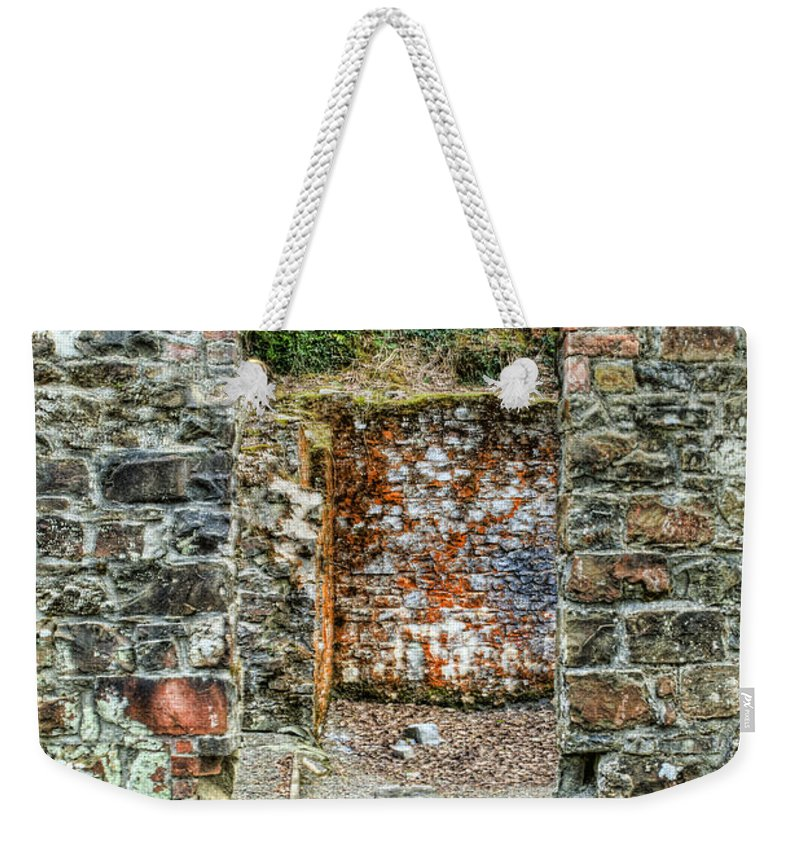 Stepaside Ironworks Weekender Tote Bag featuring the photograph Window To A Bygone Heritage by Steve Purnell