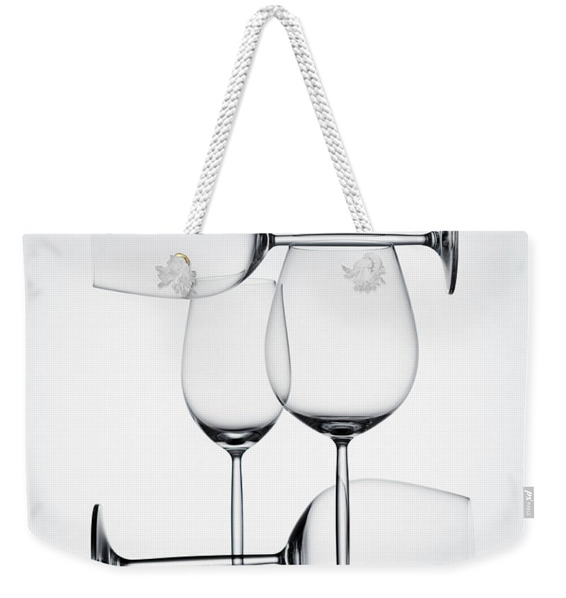 Empty Weekender Tote Bag featuring the photograph Wine Glasses by Jorg Greuel