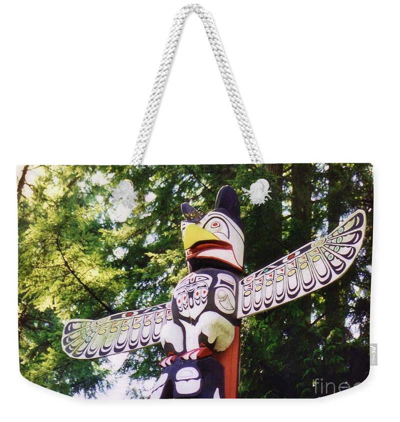 Totems Weekender Tote Bag featuring the photograph Wing Span by John Malone