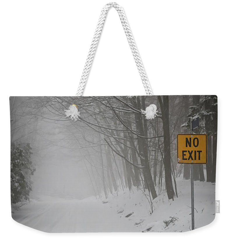 Winter Weekender Tote Bag featuring the photograph Winter Road During Snowfall I by Elena Elisseeva