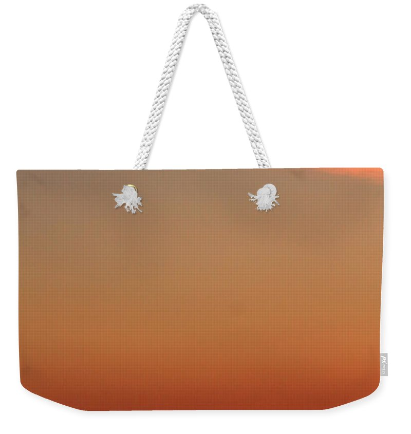 Jackson Hole Weekender Tote Bag featuring the photograph Wispy Morning Clouds by Catie Canetti