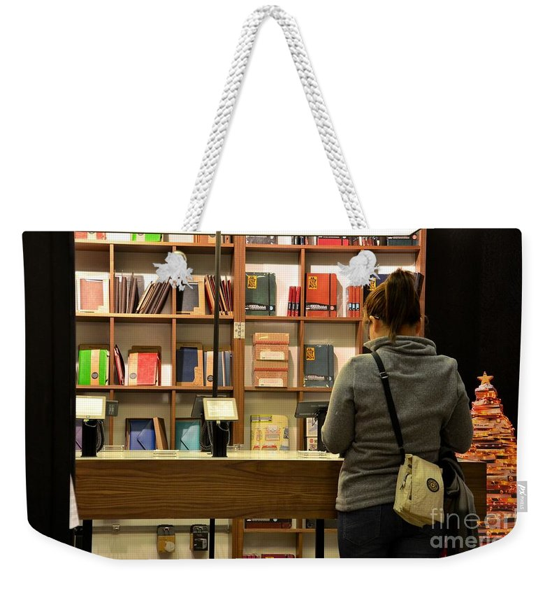 Woman Browses Kindle And Books At Bookshop Weekender Tote Bag