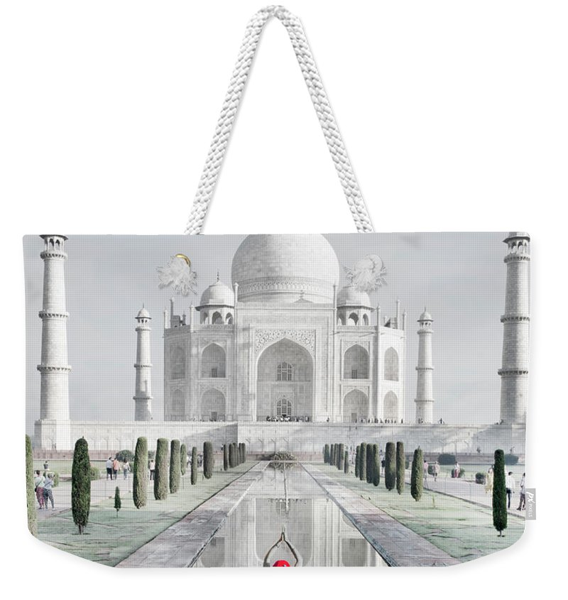 Tranquility Weekender Tote Bag featuring the photograph Woman In Red Sari Praying At Taj Mahal by Grant Faint