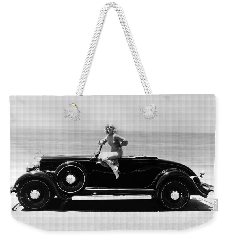 1035-440 Weekender Tote Bag featuring the photograph Woman On A Hupmobile by Underwood Archives